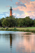 Outer Banks photo of Currituck Beach Lighthouse and reflection on a cloudy late afternoon.