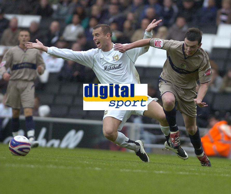 Photo: Matt Bright.<br /> Milton Keynes Dons v Stockport County. Coca Cola League 2. 27/10/2007.<br /> Aaron Wilbraham of MK Dons apeals for a penalty from a challenge of Michael Raynes of Stockport