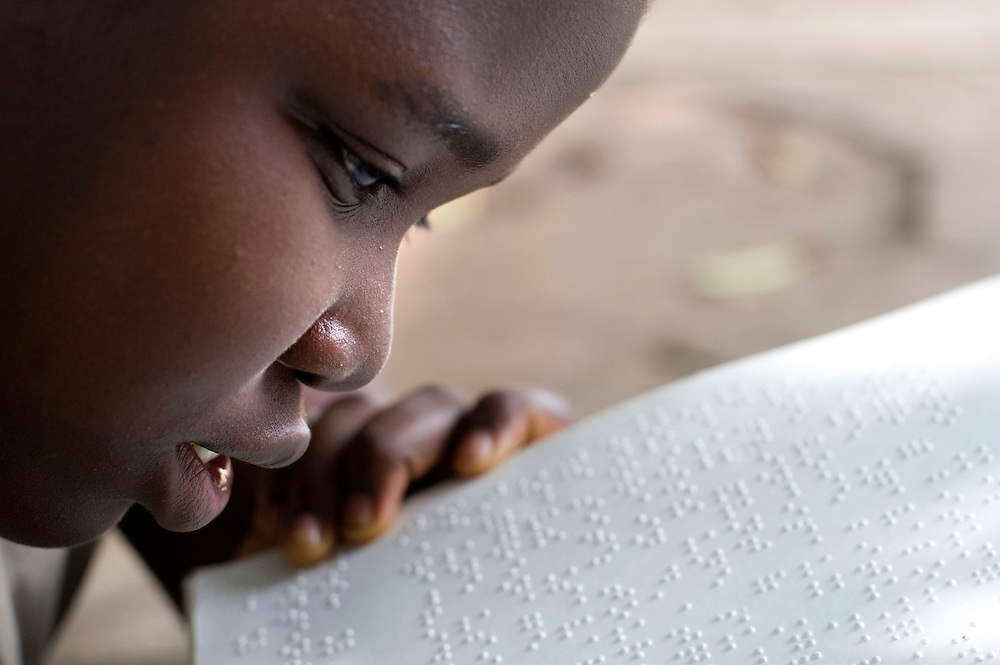 February 2008 - student at the  School for the Blind 'reads' braille in Cotonou, Benin. The School takes 80 blind students surrounding villages and at no cost to their families teaches them geography, science, math and a work for the future. Though the school belongs to the state, it receives considerable funding from ONG.
