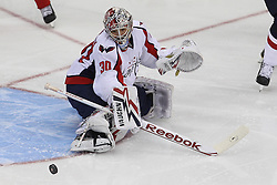 Mar 18; Newark, NJ, USA; Washington Capitals goalie Michal Neuvirth (30) makes a save during the first period of their game against the New Jersey Devils at the Prudential Center.