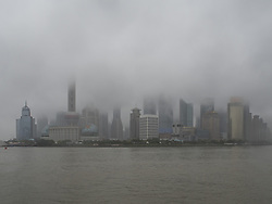 October 21, 2016 - Shanghai, Shanghai, China - Shanghai,CHINA-October 21 2016: (EDITORIAL USE ONLY. CHINA OUT)Tourists visit the Bund in rainy day in Shanghai, October 21st, 2016.Typhoon Haima, the 22nd typhoon of the year,landed in south China's Guangdong Province at the noon of October 21st,2016. (Credit Image: © SIPA Asia via ZUMA Wire)