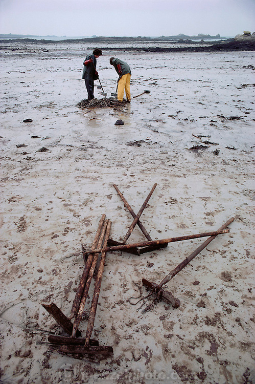 Oil spill cleanup on a beach after an oil tanker accident. The tanker, the Amoco Cadiz, split in two after running aground on rocks three miles off the coast of Brittany, France, near Portsall on March 16, 1978.