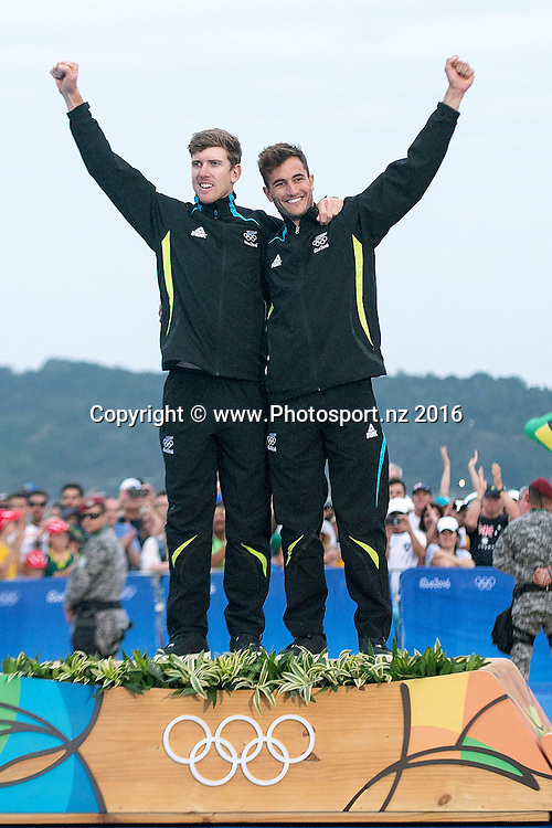 Peter Burling and Blair Tuke celebrate winning gold during the 49er class sailing race the 2016 Rio Olympics on Thursday the 18th of August 2016. © Copyright Photo by Marty Melville / www.Photosport.nz