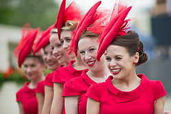 "© London News Pictures. 18/06/2013. Ascot, UK.  ""The Tootsie Rollers' singing girl group pose for the media on day one of Royal Ascot at Ascot racecourse in Berkshire, on June 18, 2013.  The 5 day showcase event,  which is one of the highlights of the racing calendar, has been held at the famous Berkshire course since 1711 and tradition is a hallmark of the meeting. Top hats and tails remain compulsory in parts of the course. Photo credit should read: Ben Cawthra/LNP"