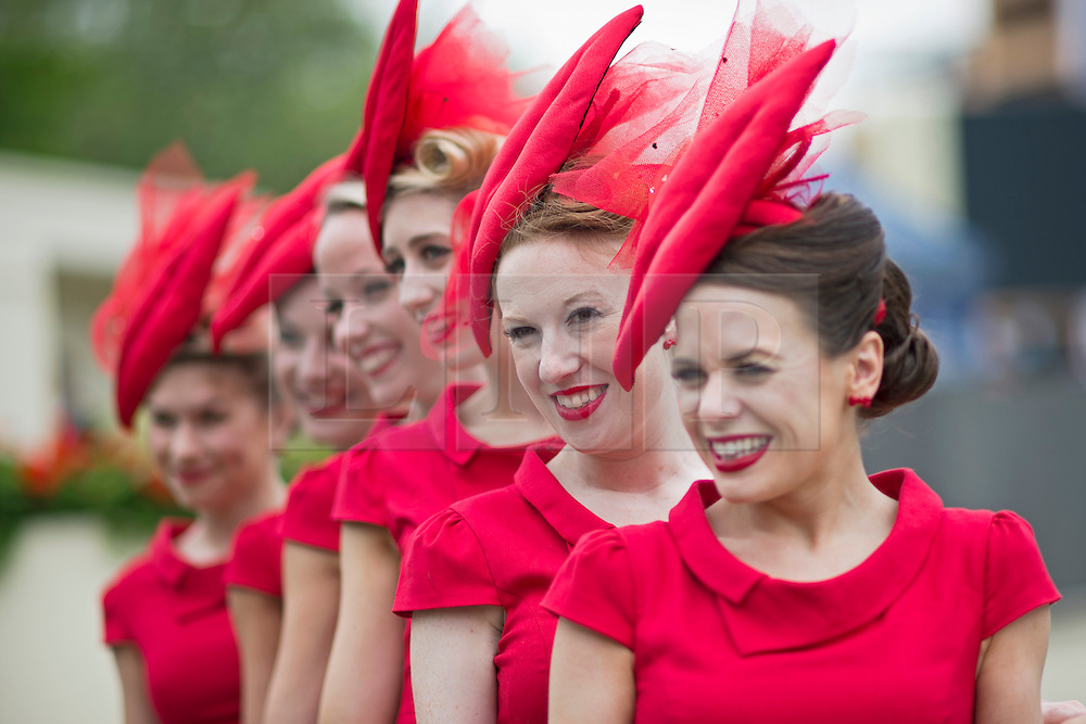 """© London News Pictures. 18/06/2013. Ascot, UK.  """"The Tootsie Rollers' singing girl group pose for the media on day one of Royal Ascot at Ascot racecourse in Berkshire, on June 18, 2013.  The 5 day showcase event,  which is one of the highlights of the racing calendar, has been held at the famous Berkshire course since 1711 and tradition is a hallmark of the meeting. Top hats and tails remain compulsory in parts of the course. Photo credit should read: Ben Cawthra/LNP"""