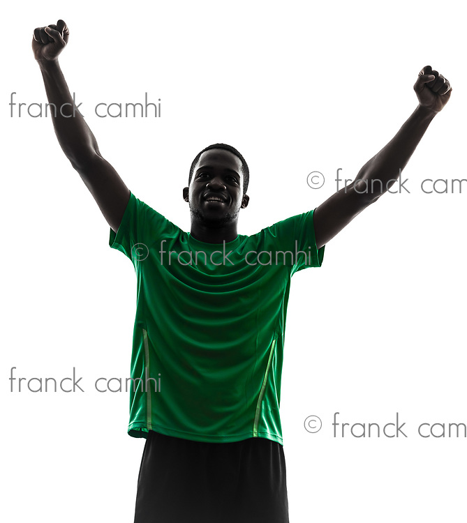 one african man soccer player celebrating victory green jersey in silhouette on white background