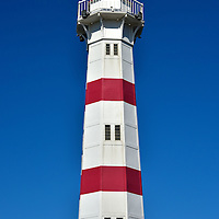 Inre Hamm Lighthouse in Malmö, Sweden<br /> This classic looking, red and white banded lighthouse (fye in Swedish) was constructed in 1878. The Inre Hamn aided ship navigation for about 105 years before being decommissioned in 1983. The octagon-shaped, cast iron tower stands 66 feet tall. The light is located at the mouth of the Inner Harbor next to the University Bridge which opened in 2004.