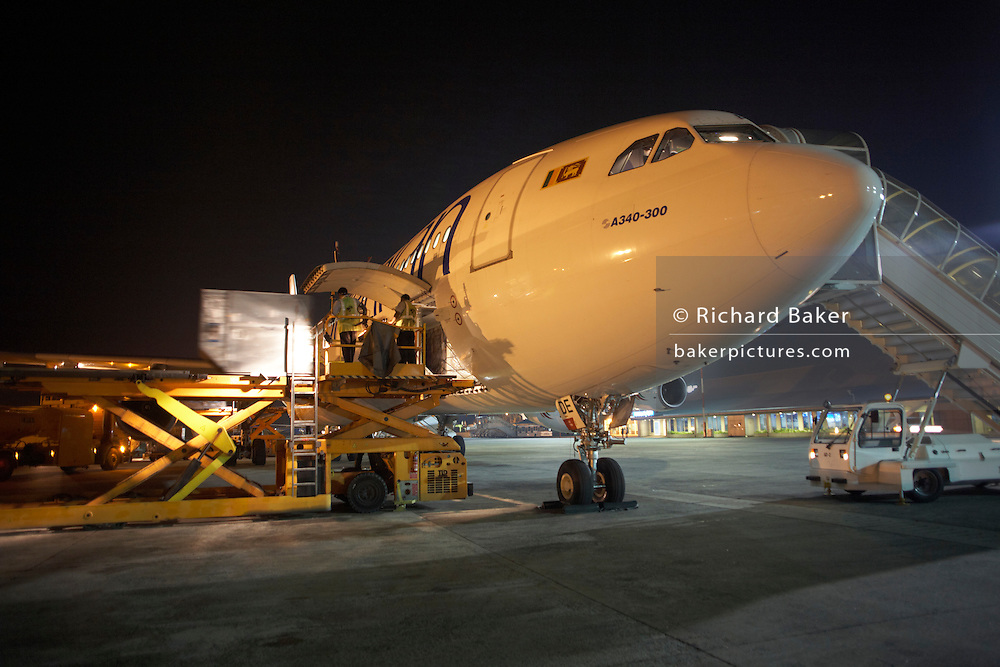 One the apron of Male International Airport, Maldives, a Sri Lankan Airlines A340-300 series Airbus prepares for departure