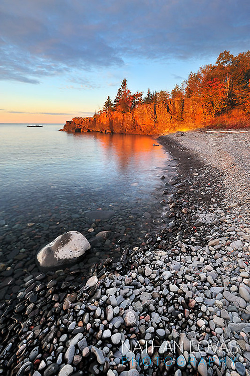 Sunrise with rock shorline along North Shore of Lake Superior;  Grand Portage, MN.