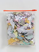 shredded bank paperwork in a plastic bag