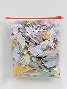 shredded bank paperwork in a plastic bag