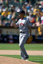 OAKLAND, CA - JUNE 22:  Koji Uehara #19 of the Boston Red Sox inspects a baseball on the pitchers mound against the Oakland Athletics during the tenth inning at O.co Coliseum on June 22, 2014 in Oakland, California. The Boston Red Sox defeated the Oakland Athletics 7-6 in 10 innings.  (Photo by Jason O. Watson/Getty Images) *** Local Caption *** <br /> Koji Uehara