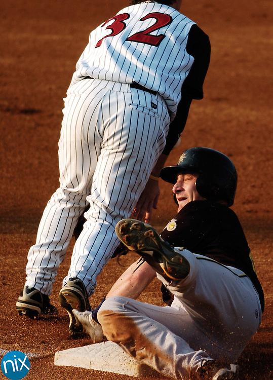 West Virginia's Jonathan Lucroy slides into third base as Kannapolis' Logan Johnson reaches for the ball.