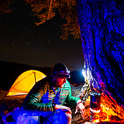 Two trail runners set up camp as nightfall descends on the Tetons of Wyoming.