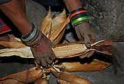 Preparing the corn for dinner.  Ngirisi Village, close to Arusha, Tanzania.