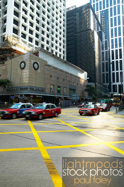Taxis crossing intersection, Hong Kong, China,