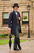 Fraser McCallum, a member of the Founders? Hall Confederation Players, leads a walking tour of historic downtown Charlottetown; Prince Edward Island, Canada.