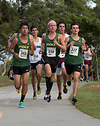 Nov 1, 2017; Long Beach, CA, USA; Daniel Bautista (343), Thomas Fleming (356) and Devin Koval (377) of Long Beach Poly run during the Moore League cross country finals at Heartwell Park.