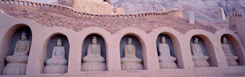 Buddha statues built into castle walls
