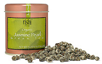 rishi green tea organic tea container and loose pile of leaves