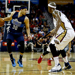 Dec 26, 2016; New Orleans, LA, USA;  Dallas Mavericks guard Seth Curry (30) is defended by New Orleans Pelicans forward Dante Cunningham (33) during the second quarter of a game at the Smoothie King Center. Mandatory Credit: Derick E. Hingle-USA TODAY Sports