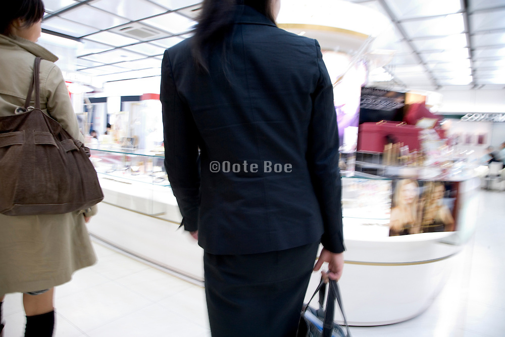 girls shopping at a cosmetic luxury store in Tokyo Japan