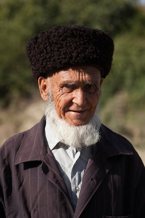 An old religious man with traditional hat and beard, in the Kopet Dag mountains of Turkmenistan