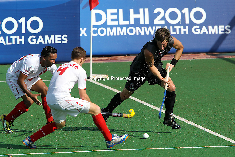 Simon Child of New Zealand attacks during the hockey match between New Zealand and Canada during the XiX Commonwealth Games  held at the MDC Stadium in New Delhi, India on the  10 October 2010<br /> <br /> Photo by:  Ron Gaunt/photosport.co.nz
