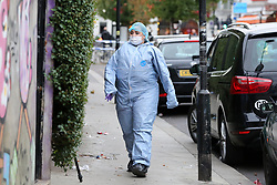 © Licensed to London News Pictures. 22/09/2019. London, UK. A forensics officer on Langham Road in North London near Turnpike Lane underground and bus station where three men were stabbed and rushed to hospital. Met police were call shortly after 4pm this afternoon to Langham Road and found three men suffering from stab wounds. According to the Met Police, two men have been arrested on suspicion of GBH. Photo credit: Dinendra Haria/LNP