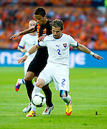 In action for   Ibrahim Afellay  The Netherlands versus   Peter Pakarik   Slovakia during friendly soccer match between Netherlands vs Slovakia in Rotterdam on May 30, 2012. AFP PHOTO/ ROBIN UTRECHT