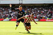 Connor Wickham of Crystal Palace fouls George Baldock of Sheffield United during the Premier League match between Sheffield United and Crystal Palace at Bramall Lane, Sheffield, England on 18 August 2019.