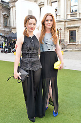HOLIDAY GRAINGER and OLIVIA HALLINAN at the annual Royal Academy of Art Summer Party held at Burlington House, Piccadilly, London on 4th June 2014.