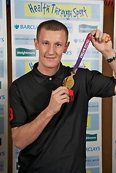 LIVERPOOL, ENGLAND - Friday, November 26, 2010: Boxer Tom Stalker with his Commonwealth lightweight Boxing Bronze Medal during a Health Through Sport Charity Dinner at the Devonshire House. (Photo by David Rawcliffe/Propaganda)