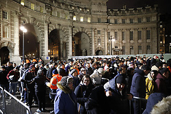 © Licensed to London News Pictures. 31/12/2017. London, UK. Ticket holders line up to enter the secure area to watch the New Year's Eve fireworks at midnight. Photo credit: Peter Macdiarmid/LNP