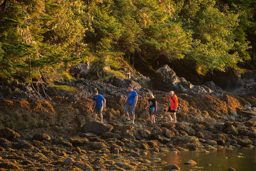 Canada, British Columbia Vancouver Island, Ucluelet, West Coast, family walking on coast