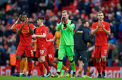 LIVERPOOL, ENGLAND - Saturday, January 28, 2017: Liverpool's Georginio Wijnaldum, Ben Woodburn, goalkeeper Loris Karius and Ragnar Klavan look dejected after losing 2-1 to Wolverhampton Wanderers during the FA Cup 4th Round match at Anfield. (Pic by David Rawcliffe/Propaganda)