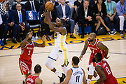 Golden State Warriors forward Kevin Durant (35) shoots a floater against the Houston Rockets at Oracle Arena in Oakland, Calif., on October 17, 2017. (Stan Olszewski/Special to S.F. Examiner)