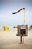 DEU, Germany, Schleswig-Holstein, North Sea,  Amrum island, renting of beach chairs at the beach Kniepsand in Nebel.<br /> <br /> DEU, Deutschland, Schleswig-Holstein, Nordseeinsel Amrum, Verleih von Strandkoerben am Strand Kniepsand in Nebel.