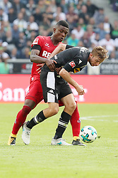 MOENCHENGLADBACH, Aug. 21, 2017  Christoph Kramer(R) of Borussia Moenchengladbach and Jhon Cordoba of 1.FC Koeln vie for the ball during the Bundesliga match between Borussia Moenchengladbach and 1. FC  Koeln at Borussia-Park on August 20, 2017 in Moenchengladbach, Germany. (Credit Image: © Ulrich Hufnagel/Xinhua via ZUMA Wire)