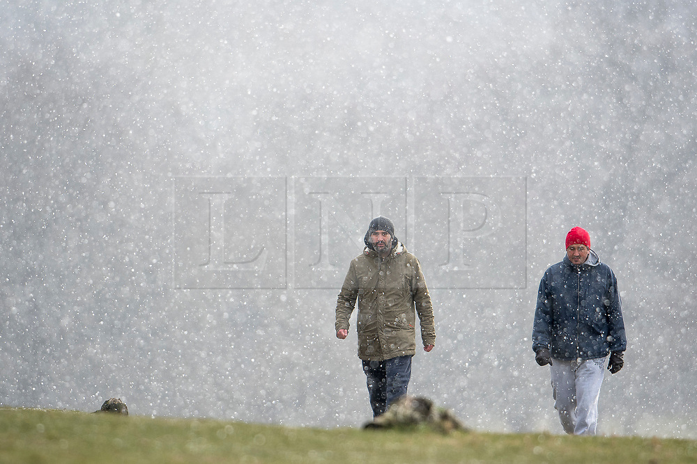 © Licensed to London News Pictures. 26/02/2018. London, UK. Walkers brave heavy snowfall and freezing temperatures in Richmond Park, west London, as a cold front sweeps in from the east. Up to 20cm of snow are expected in parts of the UK, with temperatures feeling as low as -15C in some places. Photo credit: Ben Cawthra/LNP