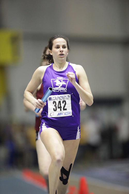 Windsor, Ontario ---13/03/09--- Jenn Webber of  the University of Western Ontario competes in the 4X800 metre relay at the CIS track and field championships in Windsor, Ontario, March 13, 2009..GEOFF ROBINS Mundo Sport Images