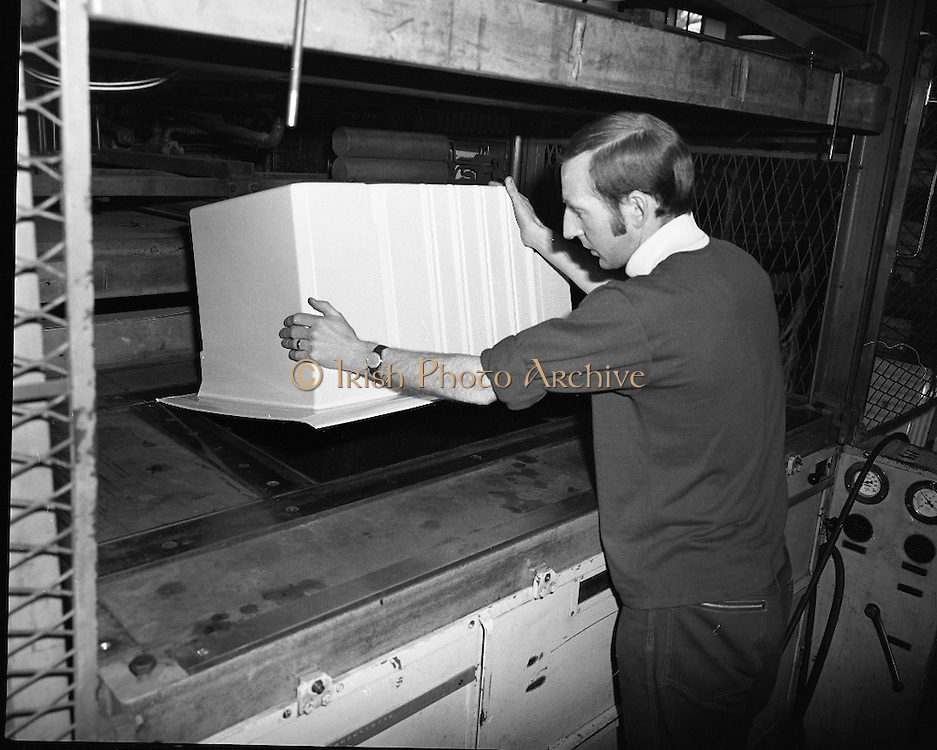 Pye Factory,fridge assembly line..1971..15.04.1971..04.15.1971..15th April 1971..The Pye factory which manufactured electrical appliances closed its doors in 1985. At the peak it Pye employed 1200 people and was the largest employer in the Dundrum area. Dundrum bowl was built on the Pye site when the factory closed, it too had its problems and closed in the early 90s due to flooding. on the site now stands the Dundrum Shopping centre which is now the centrepoint of Dundrum town centre..Image of the operative removing the moulding from the machine.It would be trimmed and cleaned in preparation for fitting to the fridge.