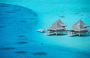 Water bungalows on stilts of the Beachcomber Hotel, Bora Bora, Society Islands, French Polynesia