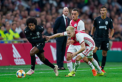 13-08-2019 NED: UEFA Champions League AFC Ajax - Paok Saloniki, Amsterdam<br />  Ajax won 3-2 and they will meet APOEL in the battle for a group stage spot / Sergino Dest #28 of Ajax, Diego Biseswar #21 of PAOK, Donny van de Beek #6 of Ajax
