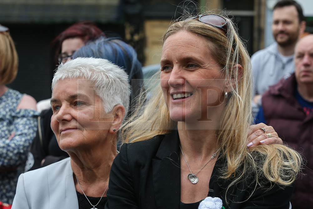 © Licensed to London News Pictures. 16/06/2017. Birstall, UK. Jo Cox's mother Jean Leadbeater and sister Kim Leadbeater watch as a choir of children sing in Birstall town square where the Labour MP was murdered a year ago today. Events are planned to take place across the country this weekend in memory of Jo Cox in what is being called 'The Great Get Together'. Credit: Ian Hinchliffe Photo credit : Ian Hinchliffe/LNP