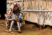 A young refugee girl from Central African Republic sits on the ground in the village of Tongo Gandima, near Bertoua, Cameroon, on Tuesday September 15, 2009.