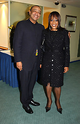 PAUL BOATENG MP and his wife JANET BOATENG at the charity Vanishing Herd Foundation - Conservation Ball held at the Radison Hotel, Portman Square, London on 13th November 2004.<br />