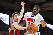 DALLAS, TX - DECEMBER 16: Jordan Tolbert #23 of the SMU Mustangs has the ball knocked out of his hands by Zach Young #10 of the Nicholls State Colonels on December 16, 2015 at Moody Coliseum in Dallas, Texas.  (Photo by Cooper Neill/Getty Images) *** Local Caption *** Jordan Tolbert; Zach Young