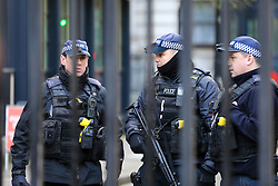© Licensed to London News Pictures. 30/11/2019. London, UK. Armed police officers patrol Downing Street amid heightened security following the London Bridge terror attack on Friday 29 November 2019. Photo credit: Dinendra Haria/LNP