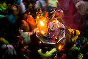Hindu's celebrate Holi in the Banke Bihari Temple in Vrindavan, in the Mathura district of Uttar Pradesh, India ,28th February 2010. <br /> <br /> Holi, also called the Festival of Colours, is a spring festival celebrated by Hindus, Buddhists, Sikhs, Jains and others. It is primarily observed in India, Nepal, Srilanka, Pakistan, Bangladesh, and countries with a large Indian diaspora populations, such as Suriname, Guyana, South Africa, Trinidad, UK, USA, Mauritius, and Fiji. In West Bengal of India and Bangladesh it is known as Dolyatra (Doul Jatra) or Basanta-Utsav (&quot;spring festival&quot;). The most celebrated Holi is that of the Braj region, in locations connected to the god Krishna: Mathura, Vrindavan, Nandagaon, and Barsana. These places have become tourist destinations during the festive season of Holi, which lasts here to up to sixteen days.<br /> The main day, Holi, also known as Dhulheti, Dhulandi or Dhulendi, is celebrated by people throwing colored powder and colored water at each other. Bonfires are lit the day before, also known as Holika Dahan (burning of Holika) or Chhoti Holi (little Holi). The bonfires are lit in memory of the miraculous escape that young Prahlad accomplished when Demoness Holika, sister of Hiranyakashipu, carried him into the fire. Holika was burnt but Prahlad, a staunch devotee of god Vishnu, escaped without any injuries due to his unshakable devotion. Holika Dahan is referred to as Kama Dahanam in Andhra Pradesh.<br /> <br /> PHOTOGRAPH BY AND COPYRIGHT OF SIMON DE TREY-WHITE<br /> <br /> + 91 98103 99809<br /> + 91 11 435 06980<br /> +44 07966 405896<br /> +44 1963 220 745<br /> email: simon@simondetreywhite.com photographer in delhi photographer in delhi photographer in delhi